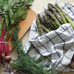 Asparagus and radishes on a towel